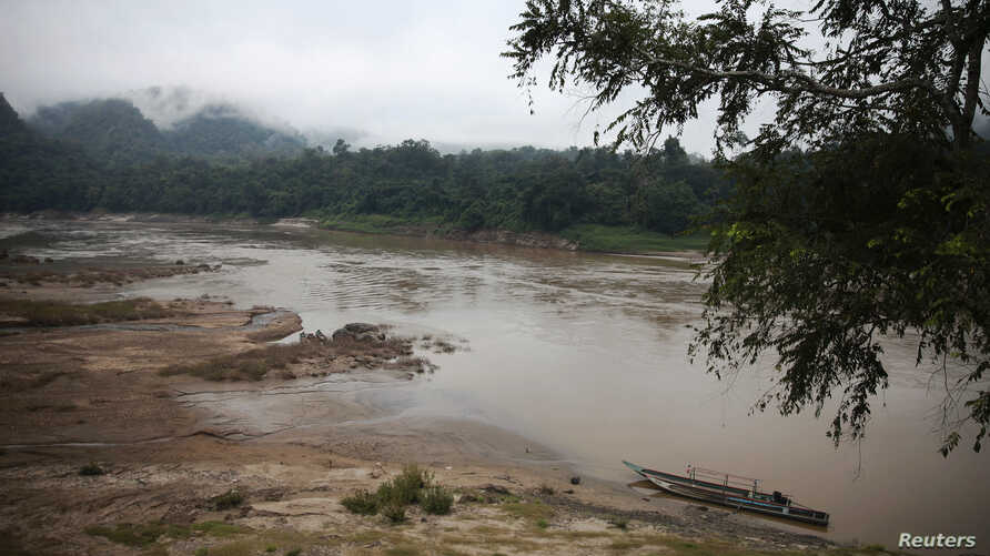 FILE - A view of the Salween River is seen from a small Thai-Karen village on the Thai side of the river, Nov. 17, 2014.
