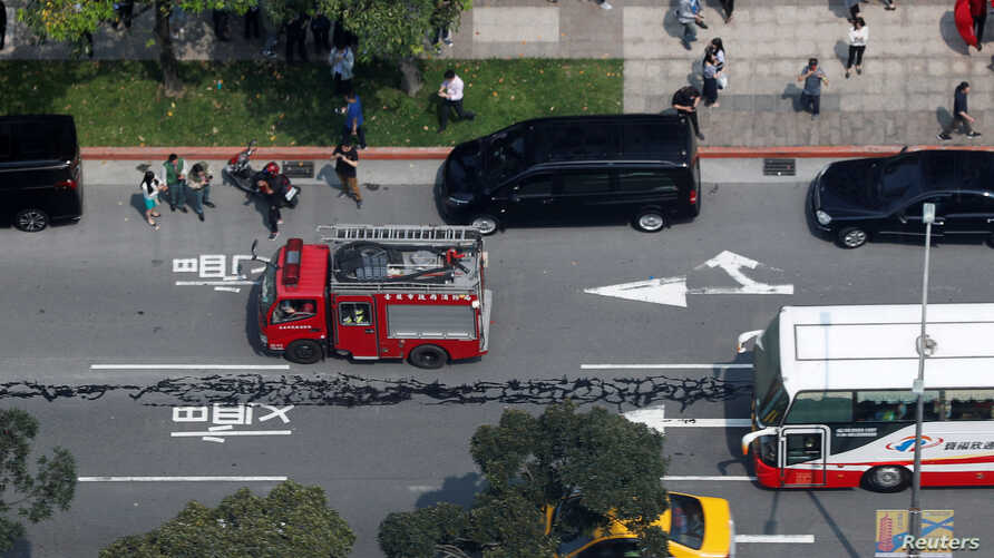 A major road in the center of Taipei is seen damaged after an earthquake in Taipei, Taiwan, April 18, 2019.