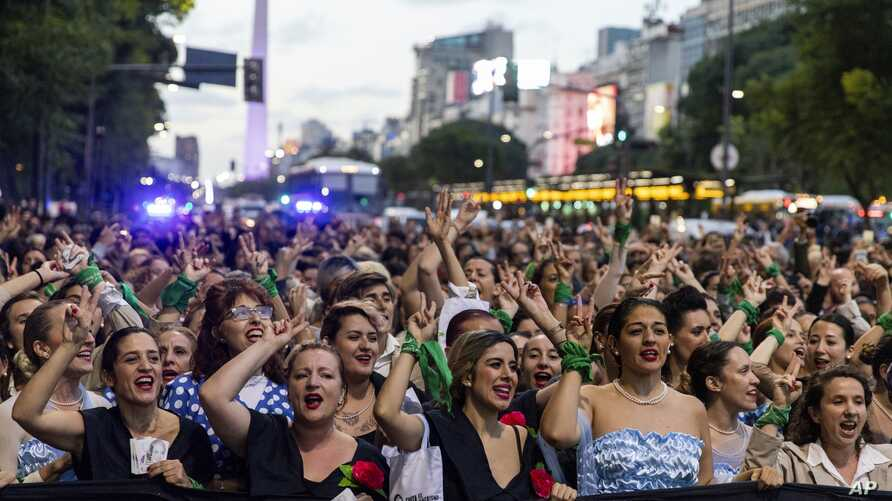Women dressed as Eva Peron parade down the streets of Buenos Aires, Argentina, May. 6, 2019.