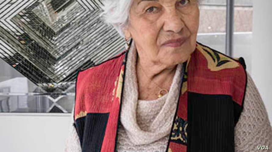FILE -- Artist Monir Shahroudy Farmanfarmaian, shown with her work, Infinite Possibility. Mirror Works and Drawings 1974–2014, on March 10, 2015..