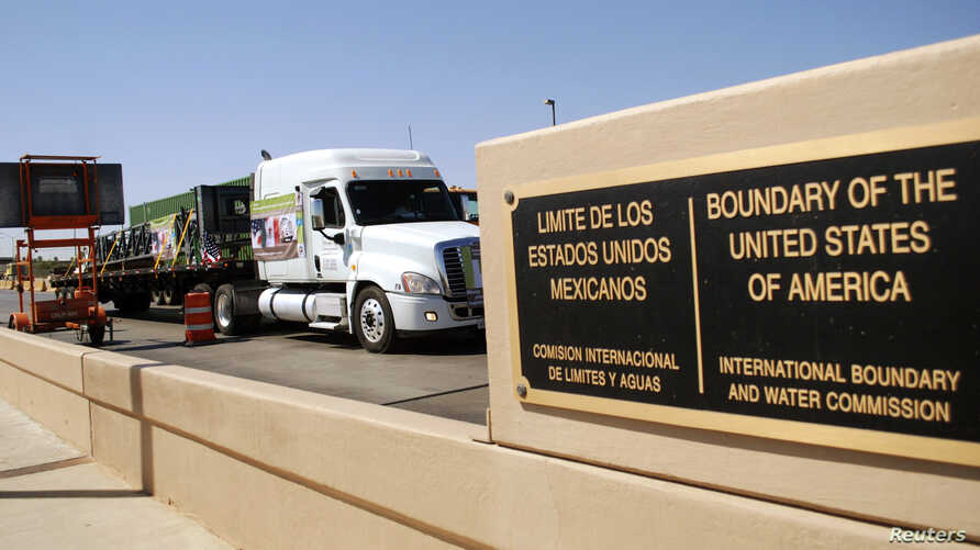 FILE - A truck of the Mexican company Olympics crosses the Puente Internacional Comercio Mundial (World Trade International Bridge) while approaching the border crossing into the U.S., in Laredo.