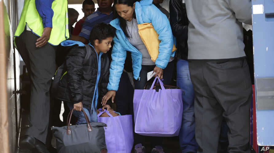 FILE - Immigrants from Central America seeking asylum board a bus, April 2, 2019, in downtown San Antonio. The surge of migrants arriving at the southern border has led the Trump administration to dramatically expand a practice it has long mocked as ...