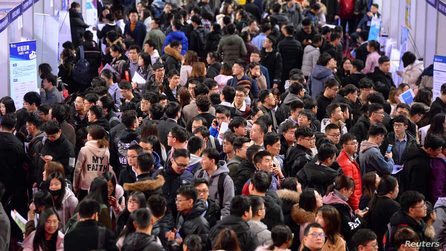 FILE - Students are seen at a job fair for graduates at a university in Shenyang, Liaoning province, China, March 21, 2019.