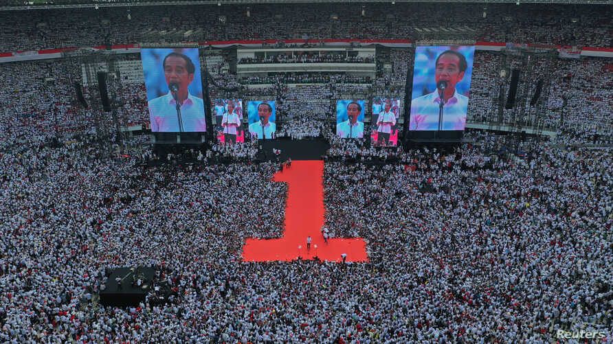 Indonesia's incumbent presidential candidate addresses to supporters during a campaign rally at Gelora Bung Karno stadium in Jakarta, Indonesia, April 13, 2019 in this photo taken by Antara Foto.
