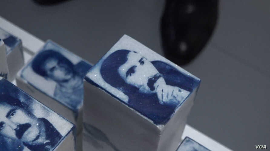 The faces of people whose disappearances are blamed by rights groups on Turkish security forces are seen at an art exhibition in Istanbul. Most of the disappearances were in connection with the conflict with Kurdish rebels. (D. Jones/VOA)