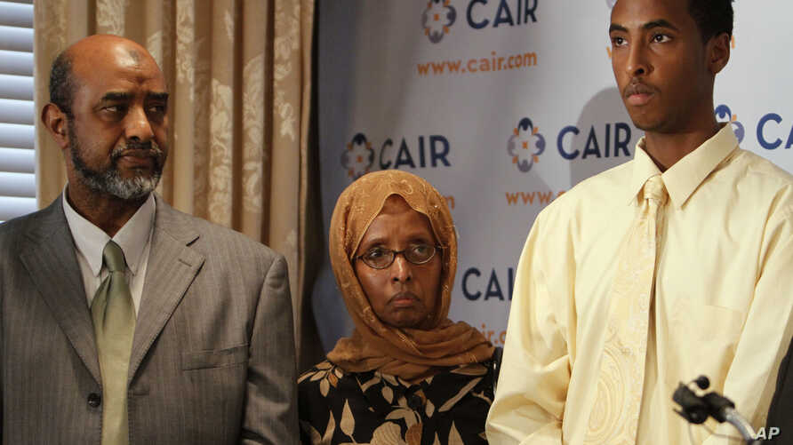 FILE - Abdirizak Wehelie and Shamsa Noor attend a news conference about their son Yahya Wehelie, as their son Yusuf Wehelie speaks, in Washington, on June 16, 2010. A U.S. citizen Yahya Wehelie was detained in Cairo and not allowed to fly home to the...