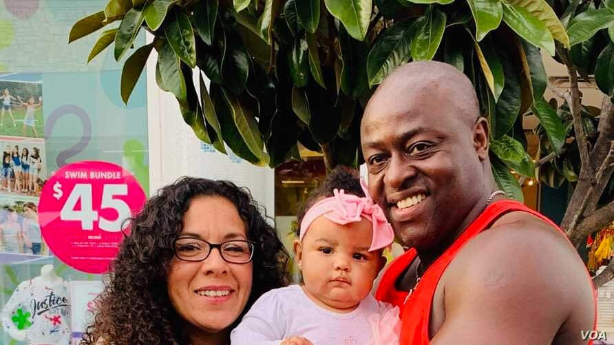Sylvester Owino with his daughter and wife.