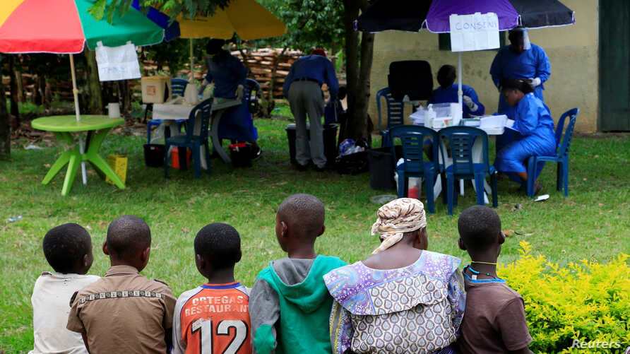 Ugandan civilians queue to be vaccinated against the Ebola virus in Kirembo village, near the border with the Democratic Republic of Congo in Kasese district, Uganda, June 16, 2019.
