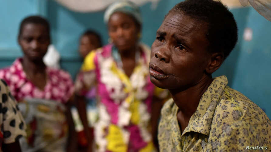 A Congolese victim of ethnic violence rests inside a ward at the General Hospital in Bunia, Ituri province, in the eastern Democratic Republic of Congo, June 25, 2019.