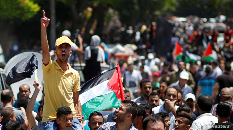 A Palestinian demonstrator gestures as he chants slogans during a protest against Bahrain's workshop for U.S. Middle East peace plan, in Gaza City, June 26, 2019.