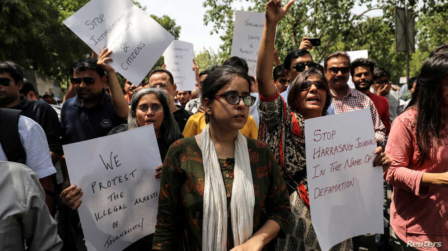 Jagisha Arora, wife of Prashant Kanojia, a journalist who was arrested for allegedly tweeting defamatory content against Uttar Pradesh's Chief Minister Yogi Adityanath, takes part in a protest with media members in New Delhi, India, June 10, 2019.