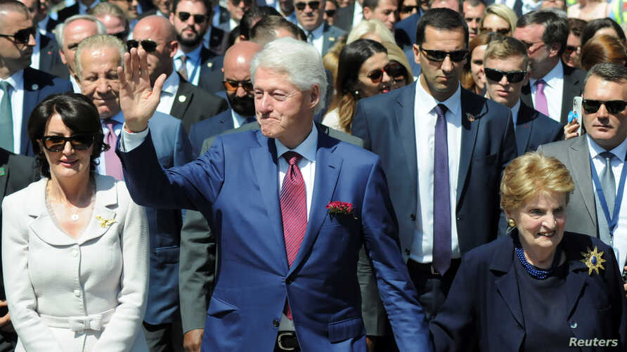 Former U.S. President Bill Clinton and Madeleine Albright walk during the 20th anniversary of the Deployment of NATO Troops in Kosovo in Pristina, Kosovo,  June 12, 2019.