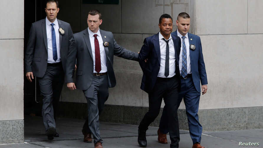 Actor Cuba Gooding Jr. is escorted handcuffed by NYPD officers as he exits the New York City Police Department's (NYPD) Special Victims Division (SVU) in the Harlem neighbourhood of New York, U.S., June 13, 2019.