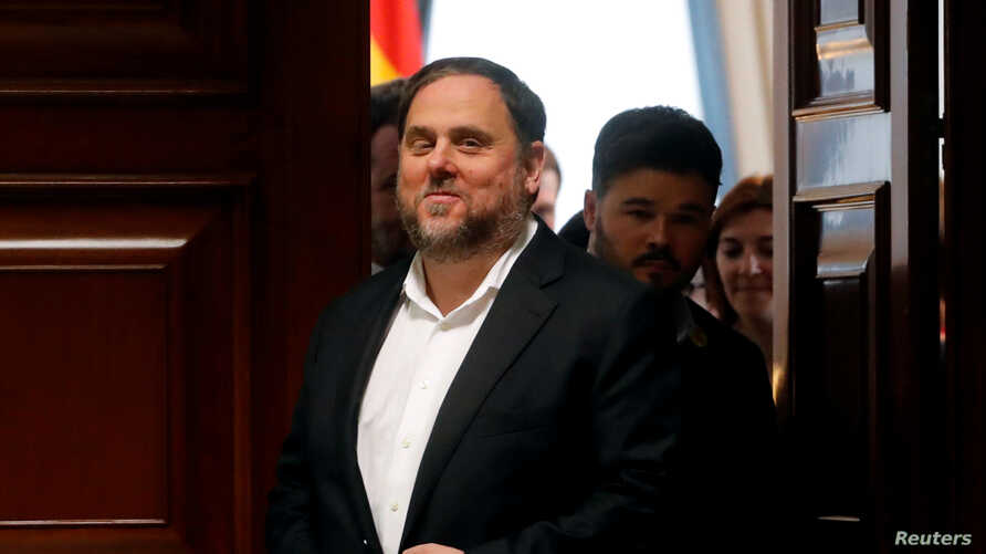 FILE - Jailed Catalan politician Oriol Junqueras leaves after getting his parliamentary credentials at Spanish Parliament, in Madrid, Spain, May 20, 2019.