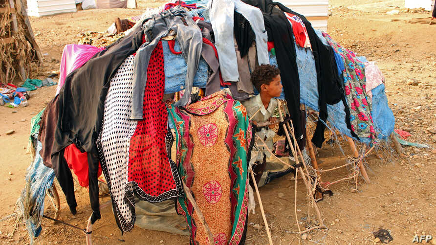 A displaced child who fled the fighting sits at a makeshift camp in the district of Abs, in Yemen's northwestern Hajjah province, June 10, 2019.