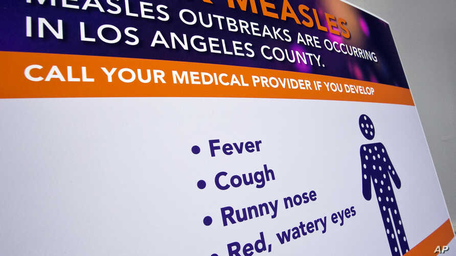 A poster released by Los Angeles County Department of Public Health is seen as experts answer questions regarding the measles response and the quarantine orders in Los Angeles, April 26, 2019.