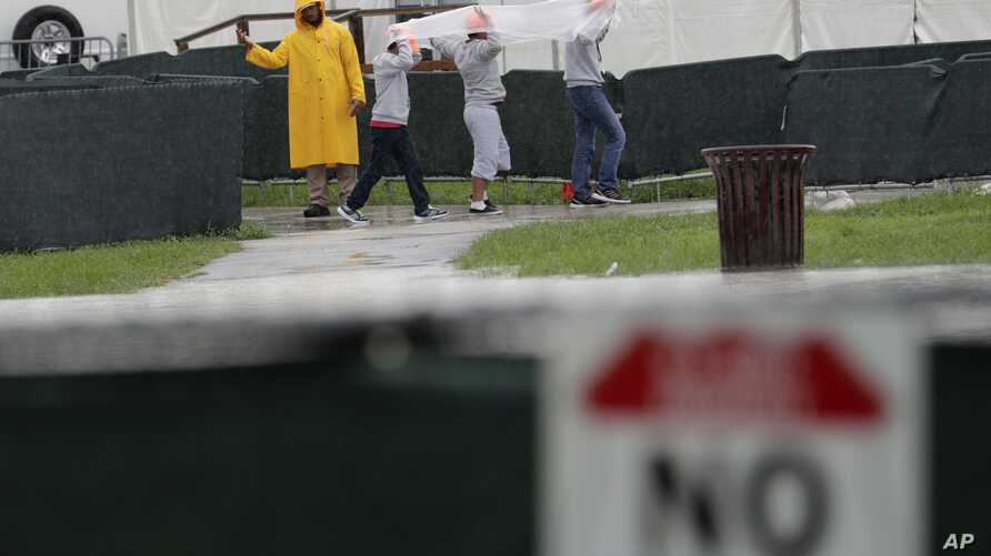 Migrant children walk on the grounds of the Homestead Temporary Shelter for Unaccompanied Children, June 16, 2019, in Homestead, Florida.