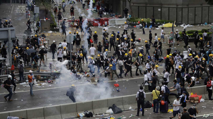 Riot police fire tear gas to protesters outside the Legislative Council in Hong Kong, June 12, 2019.