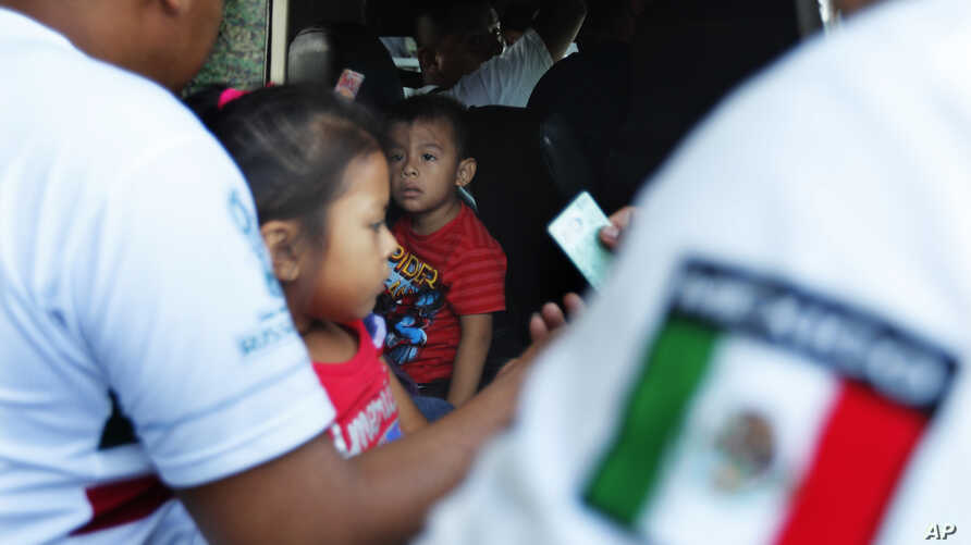 Mexican migration officials check peoples' identification cards at a checkpoint in Tapachula, Chiapas state, Mexico, June 9, 2019.
