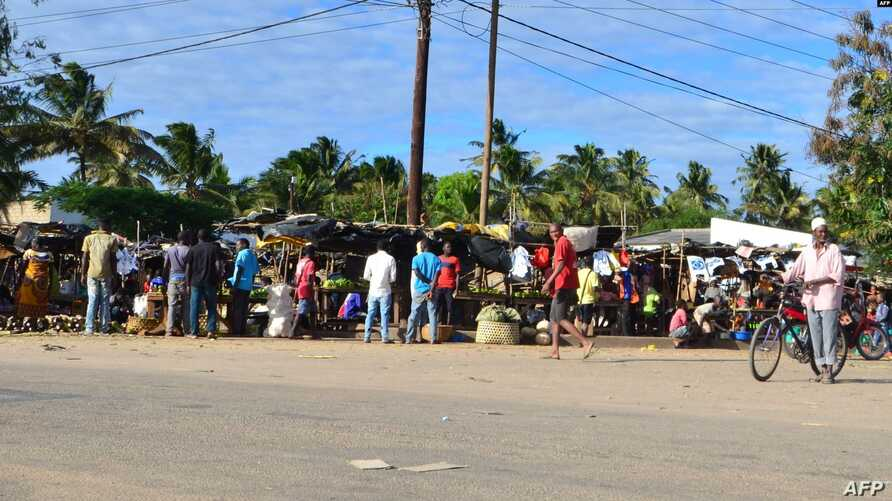 FILE - Residents visit a market in Macomia, northern Mozambique, June 11, 2018. Some experts believe IS has already set its sights on Mozambique, particularly its northern region because of the economic disparity that, in part, allows radical Islamist ideology to flourish.