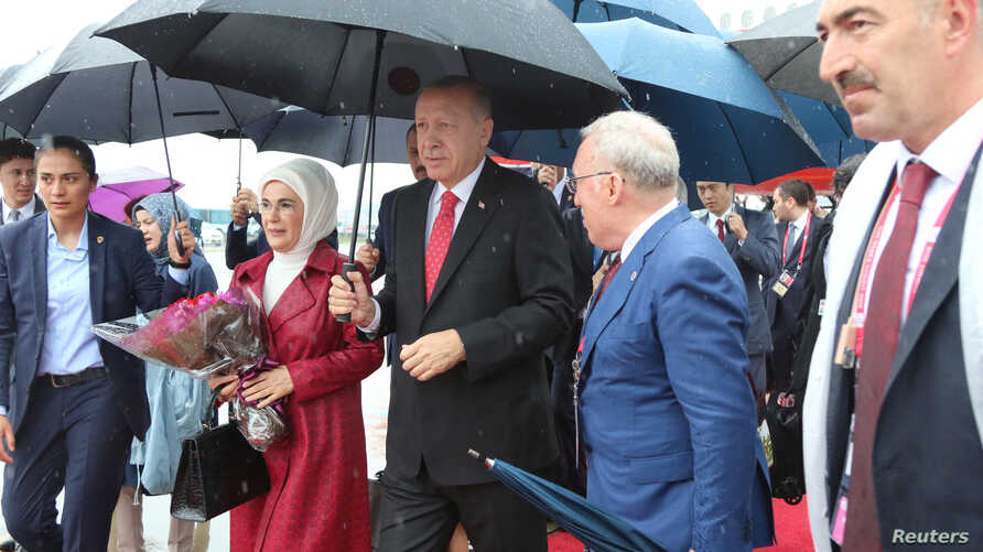 Turkish President Tayyip Erdogan and his wife Emine arrive at Kansai International Airport ahead of the start of G-20 leaders summit, in Izumisano, Osaka prefecture, Japan, June 27, 2019.