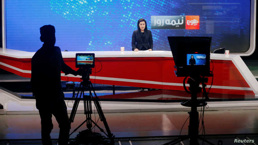 An anchor at Tolo TV delivers the news at the station's studio, in Kabul, Afghanistan, Sept. 7, 2018.