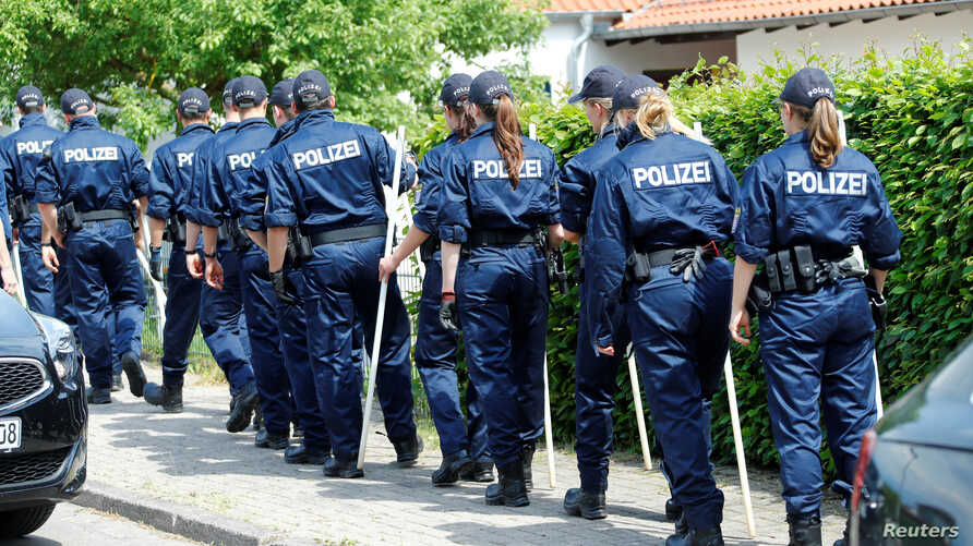 German police officers search property around the house of District President of Kassel Walter Luebcke, who was found dead in Wolfhagen-Istha near Kassel, Germany, June 3, 2019.