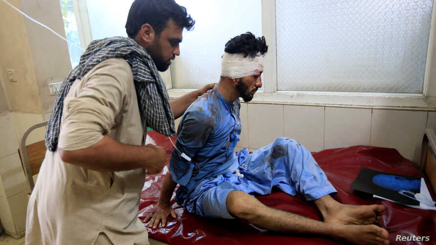 An injured man receives a treatment at the hospital, after a suicide attack in Jalalabad, Afghanistan, June 13, 2019.