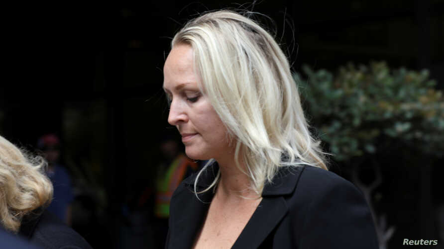 U.S. Rep. Duncan Hunter's wife Margaret Hunter leaves the federal court in San Diego, California, June 13, 2019.