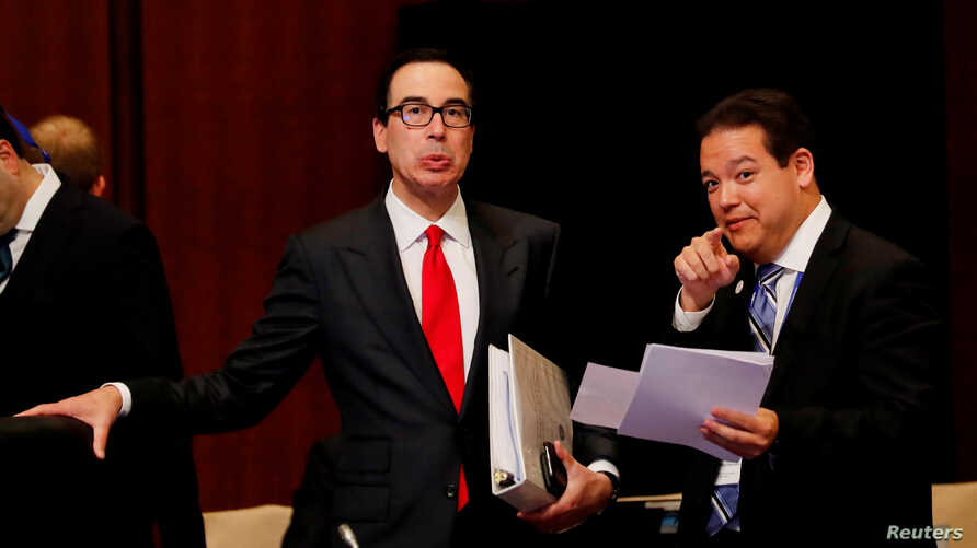 U.S. Treasury Secretary Steven Mnuchin talks with a delegate during the G20 finance ministers and central bank governors meeting in Fukuoka, Japan, June 8, 2019.
