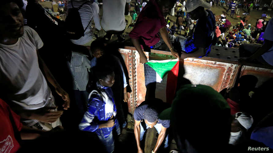 FILE - Sudanese protesters attend a demonstration along the streets of Khartoum, May 22, 2019.