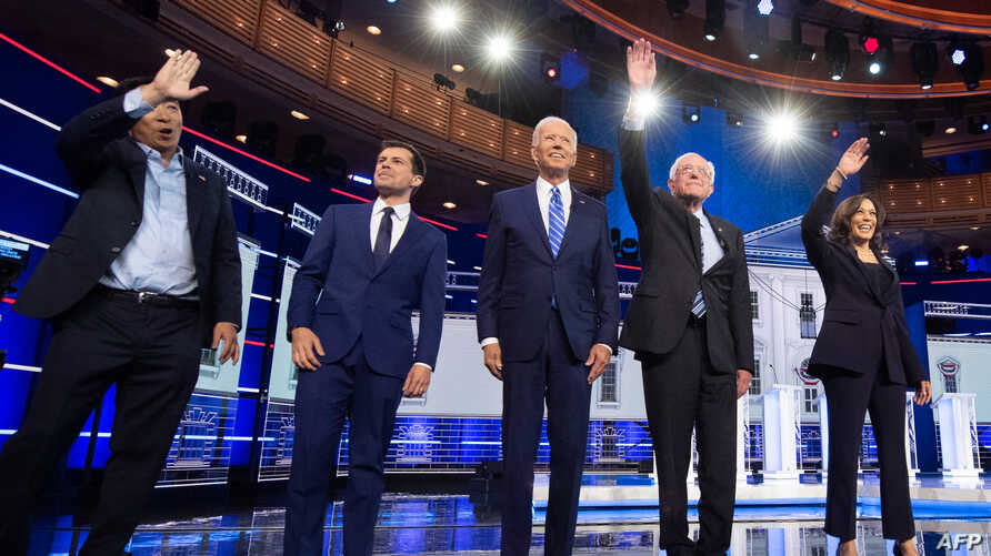 Democratic presidential hopefuls arrive on stage for the second Democratic primary debate of the 2020 presidential campaign seas