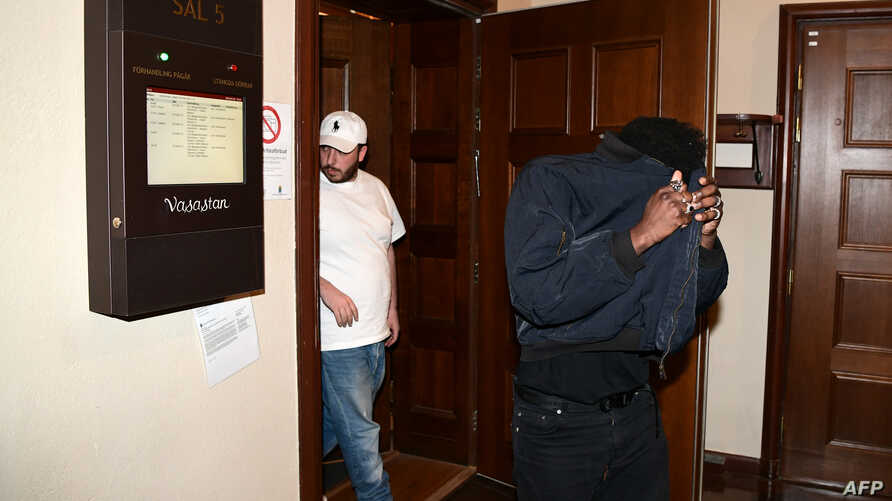 FILE - Members of the entourage of US rapper Rakim Mayers, known by his stage name Asap Rocky, leave a courtroom after a hearing in his trial over a street brawl on July 5, 2019 in Stockholm.