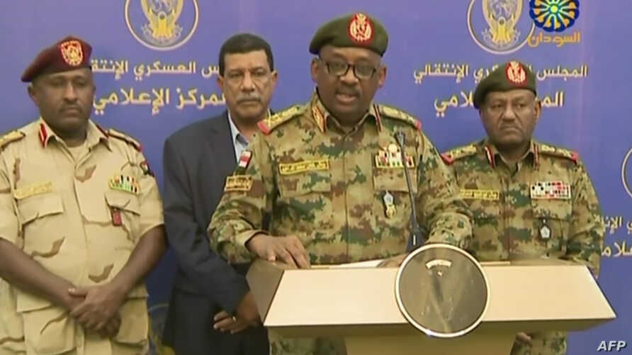 Image from a Sudan TV broadcast, July 11, 2019, shows General Jamal Omar (C), a member of Sudan's Transitional Military Council (TMC), delivering a speech in Khartoum.