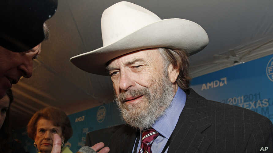 FILE - Actor Rip Torn arrives on the red carpet at the Texas Film Hall of Fame Awards in Austin, Texas, March 10, 2011.