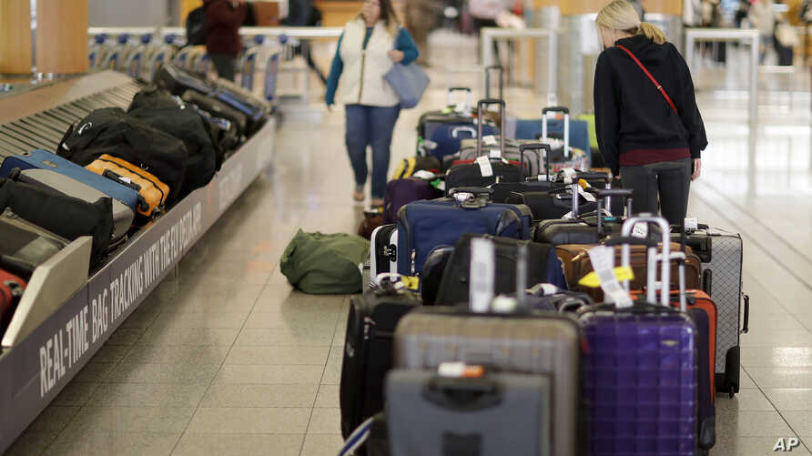 Unclaimed bags sit in baggage claim at Hartsfield-Jackson Atlanta International Airport in Atlant. Atlanta's city council has approved a far-reaching ban on smoking and vaping in restaurants, bars and inside the airport.