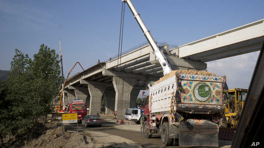 FILE - Work is in progress at a new international trade route near Havalian in Pakistan, May 11, 2017, as part of China's 'Belt and Road Initiative.'