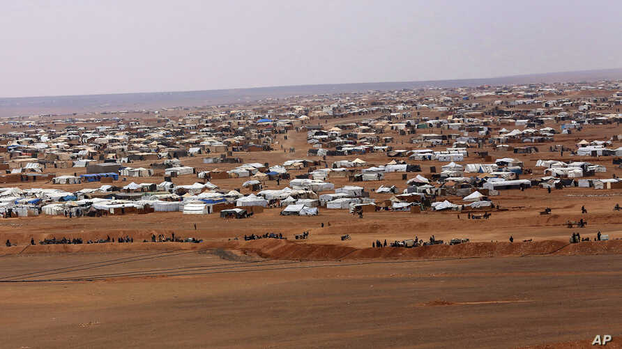 FILE - An aerial view shows the informal Rukban camp, between the Jordan and Syria borders, Feb. 14, 2017.