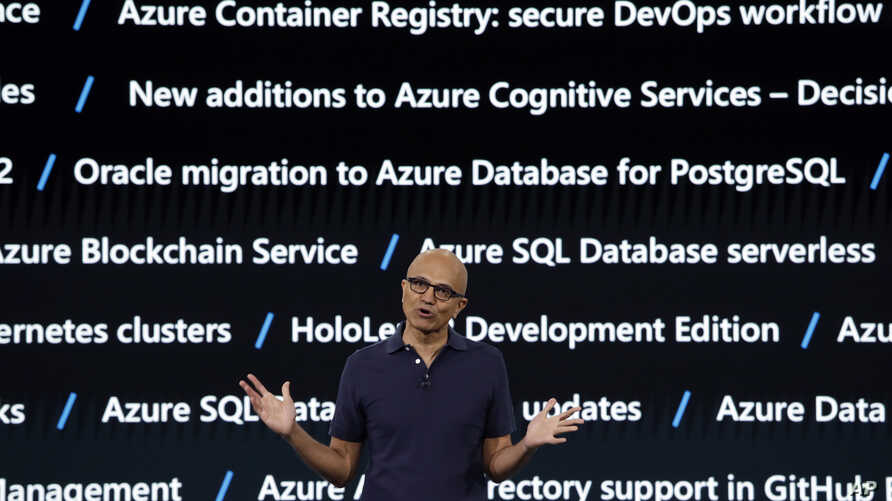 FILE - With a background screen showing new services for Microsoft's Azure cloud computing platform, CEO Satya Nadella delivers the keynote address at Build, the company's annual conference for software developers, May 6, 2019, Seattle, Washington.