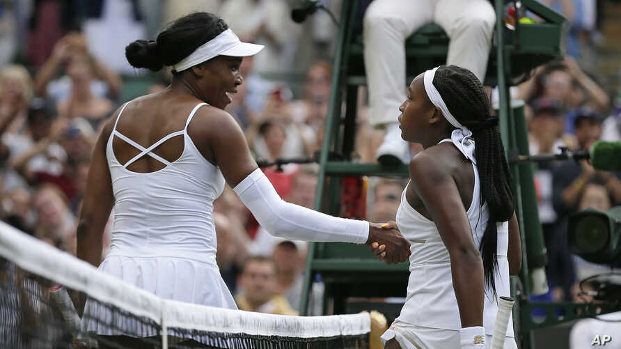 """United States' Cori """"Coco"""" Gauff, right, greets the United States' Venus Williams at the net after winning their Women's singles match during day one of the Wimbledon Tennis Championships in London, July 1, 2019."""