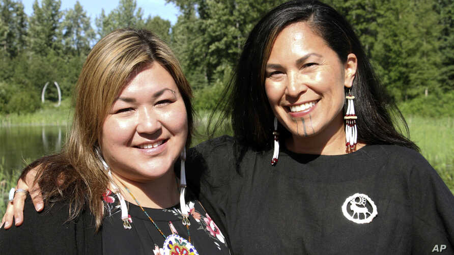 "FILE - Rochelle Adams (L), an Alaska Native cultural advisor, and Princess Johnson, the creative producer for the series ""Molly of Denali"" appear at the Alaska Native Heritage Center in Anchorage, Alaska, June 19, 2019."