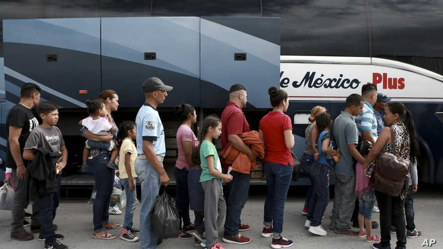 Central American migrants prepare to board a bus as they voluntarily return to their countries, in Ciudad Juarez, Mexico, July 2, 2019.