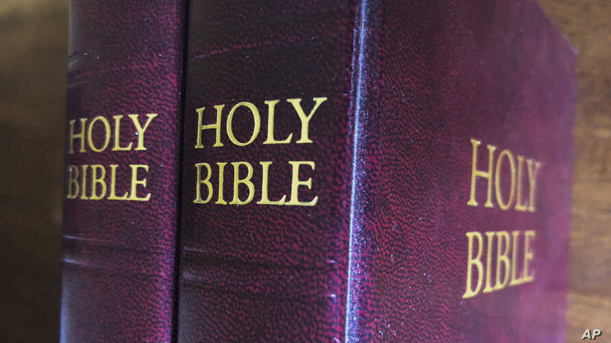 FILE - Bibles are displayed in Miami, July 5, 2019. Religious publishers say President Donald Trump's most recently proposed tariffs on Chinese imports could result in a Bible shortage.