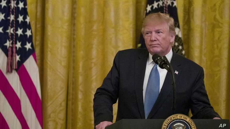 President Donald Trump pauses while speaking during an event about the environment in the East Room of the White House, July 8, 2019.