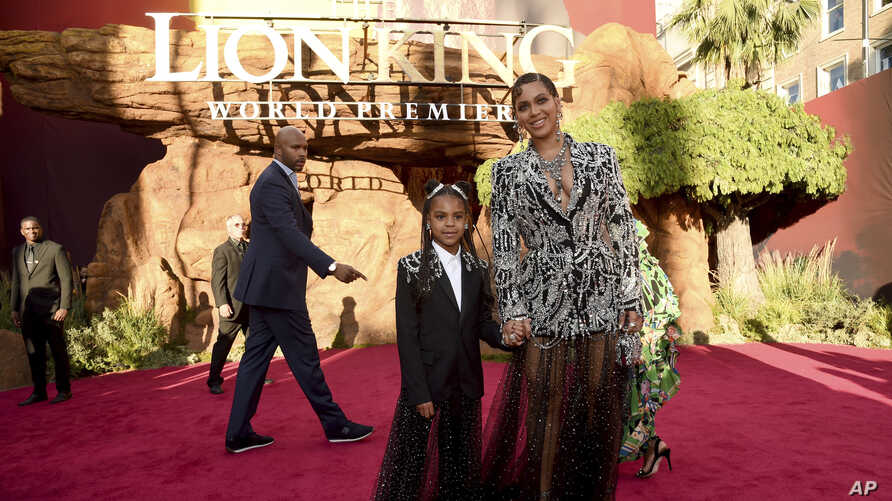 """Beyonce (R) and her daughter Blue Ivy Carter arrive at the world premiere of """"The Lion King"""" on  July 9, 2019, at the Dolby Theatre in Los Angeles, California."""