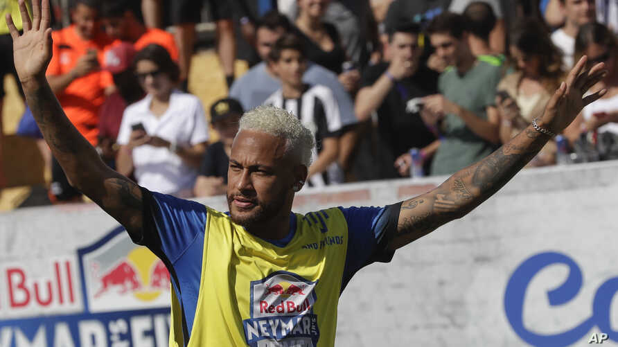 Brazilian soccer player Neymar acknowledges fans during the Neymar Jr's Five youth soccer tournament in Praia Grande, Brazil, July 13, 2019.
