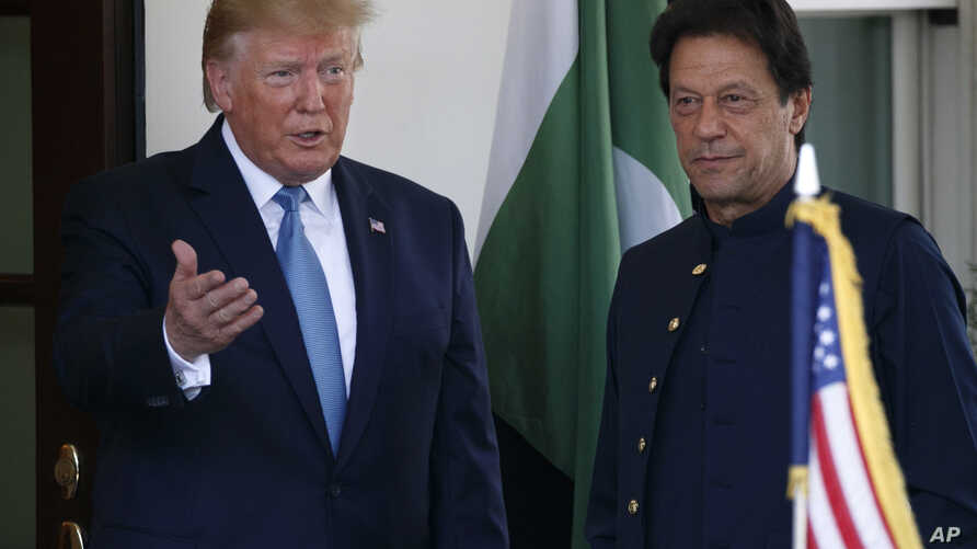 President Donald Trump gestures as he greets Pakistan's Prime Minister Imran Khan as he arrives at the White House, Monday, July 22, 2019, in Washington.