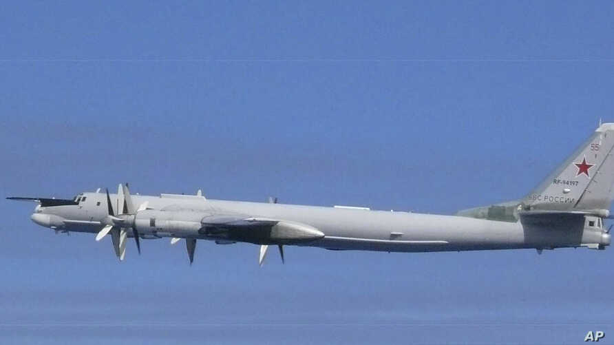 This image released by Joint Staff, Ministry of Defense, shows a Russian Tu-95 bomber which they said were flying near the Sea of Japan, July 23, 2019.