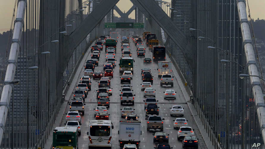 FILE - Vehicles make their way westbound on Interstate 80 across the San Francisco-Oakland Bay Bridge as seen from Treasure Island in San Francisco, Dec. 10, 2015.