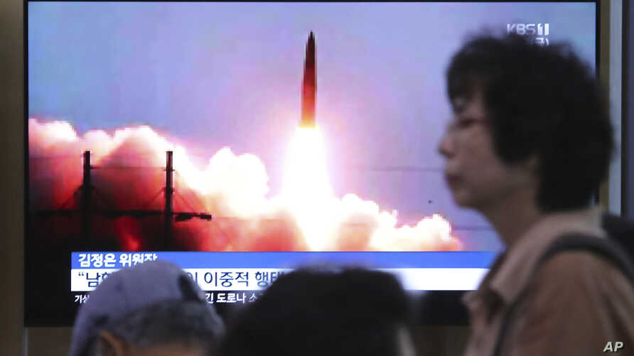 FILE - A TV screen shows an image of North Korea's missile launch during a news program at the Seoul Railway Station in Seoul, South Korea, July 26, 2019.